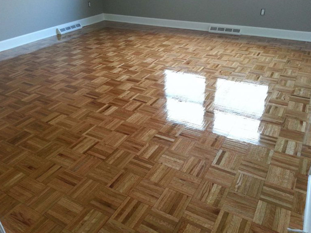 A refinished parquet hardwood floor in the Houston area.