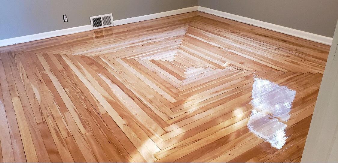 a uniquely designed hardwood floor surface.